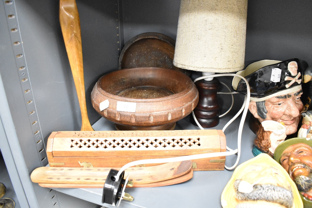 A selection of treen wood items including incense items and turned lamp base