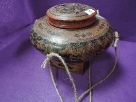 A Japanese lacquer lidded vessel having Indian dancer and animal design