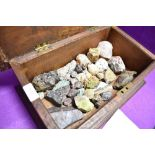 A selection of semi precious stones, rocks and minerals in an oak case