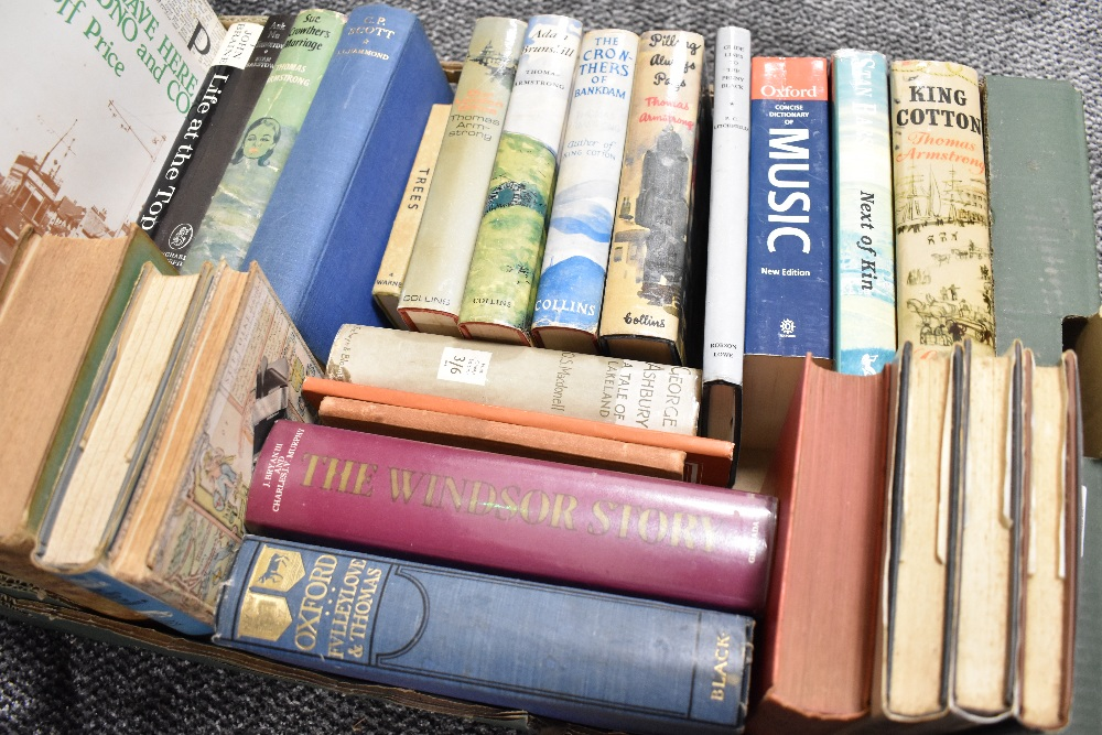A selection of hard back text and reference books including adventure literature