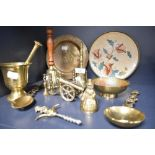 A selection of brass wares including model cannon corkscrew and mortar and pestle