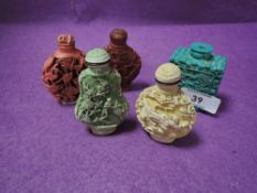 A selection of Chinese snuff bottles in cinnabar styles