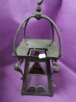 An arts and crafts lantern or light fitment having leaded light panels with painted metal and copper