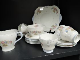 A part tea service by Shelley having a transfer printed design