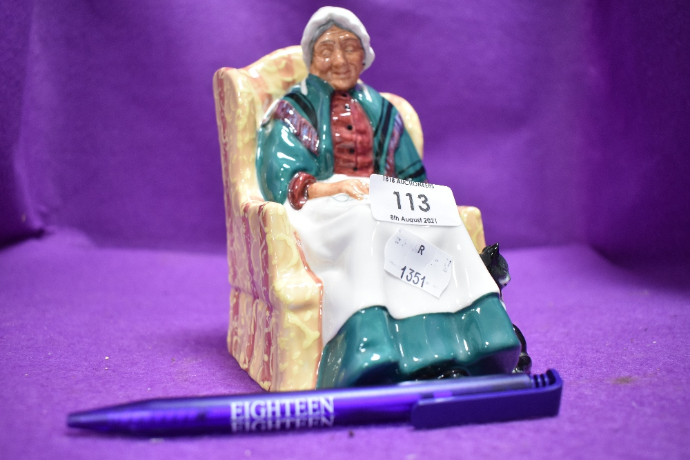 A Royal Doulton figure study forty wink on green back stamp