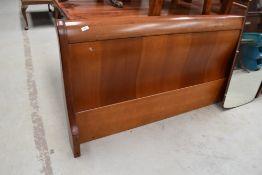 A modern hardwood bedstead, sleigh style, width approx. 6ft