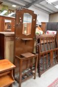 An Edwardian hall way cloak or coat stand with original hooks and mirror back
