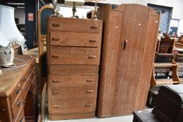 A 1930s limed oak compact bedroom suite comprising , single wardrobe, bed frame, chest of drawers