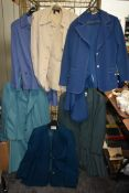 A collection of ladies retro skirt suits and jackets, different colours and styles.