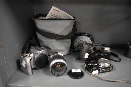 A selection of cameras including a Canon EOS300 with Canon EF28-90mm lens, a Lumix DMC TZ3 digital