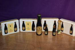 Eleven miniature bottles of Guinness, some in polystyrene presentation