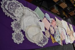 An assortment of vintage table linen, some embroidered items,linen examples included.