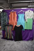 A selection of mixed vintage dresses including early 1950s grosgrain dress and patterned 60s