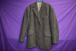 A 1970s gents Harris tweed jacket,AF, sleeve linings removed.