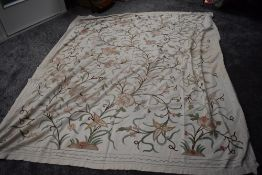A vintage Indian crewel work embroidered throw.