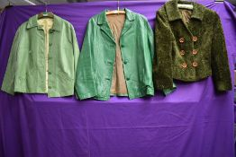 Two vintage green ladies leather jackets and a green coat.