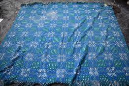 A blue,white and green Welsh wool blanket 'A dyffryn product,Cymryu am Byth'.
