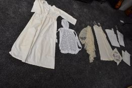 A mixed lot of vintage and antique underwear, aprons and more also included is a Victorian