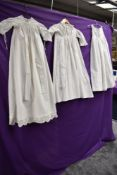 Three Victorian childrens gowns, broderie anglais and pin tuck details to hems of some.