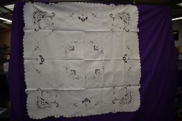 A vintage linen table cloth and napkins with cut work and embroidery.