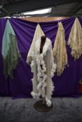 A collection of vintage and antique shawls including mint green fringed shawl,another of silk having