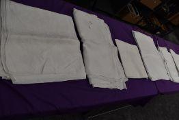 Seven antique damask table cloths.
