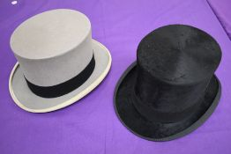 A vintage Harrods top hat and a later grey top hat.