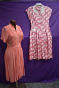 Two 1940s day dresses, one having honeycomb smocking to front the other with white lattice