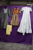 A collection of childrens vintage dresses.