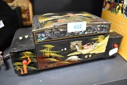 A musical jewellery box having Chinese decoration