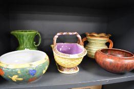 A selection of ceramics including Majolica fruit basket and art deco water jugs