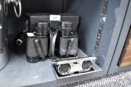 A pair of fold away pocket binoculars and a similar pair by Boots 8x30 with case