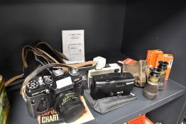 A selection of cameras including Zenit EM , Kodak instamatic 33 and Panorama