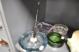 Four ash trays or trinket dishes including moulded, Art Deco pink cut and control bubble pen