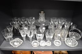 A good selection of crystal clear blown cut and etched glass wares including cocktail and cordial