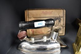 A vintage De Luxe electric iron in box