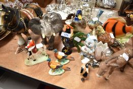 A selection of figures and figurines including Melba elephant, Beswick Donkey etc