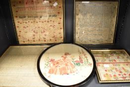 A collection of antique samplers, three having dates of 1825,1851 and 1878.