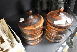 Two hand turned lignum vitae tobacco jars each 14cm tall