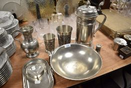 A fine selection of German pewter including Gegossen, twin handle footed bowl and large beer stein