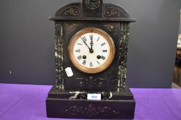 An antique marble mantel clock having roman numerals to enamel face and engraved detailing to