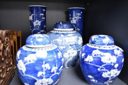 A selection of Chinese export porcelain including two tall stem vases, a large ginger jar and two