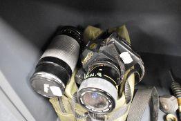 A Canon T70 camera body with Vivitar Macro 1:3.5-4.8 lens and Vivitar 1:4.2 - 5.8 Macro