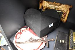 A selection of religious items including mitre hat and cast crucifix