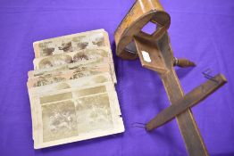 A late 19th/early 20th century 'The perfecscope' stereoscope and a collection of photographs