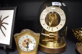 A skeleton style brass anniversary clock by Kundo and similar mantle clock