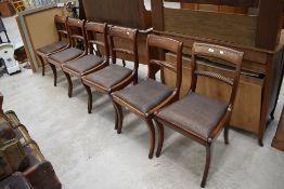 A set of six Victorian mahogany dining chairs having twist rail back