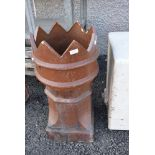 A traditional glazed crown top chimney pot