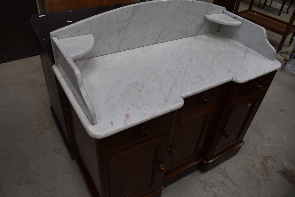 A Victorian mahogany washstand having marble top, width approx. 96cm