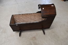 A 19th Century oak rocking crib/cot, later lining